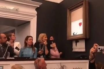 Sửng sốt bức tranh của Banksy trị giá 31 tỷ đồng tự động bị tiêu hủy