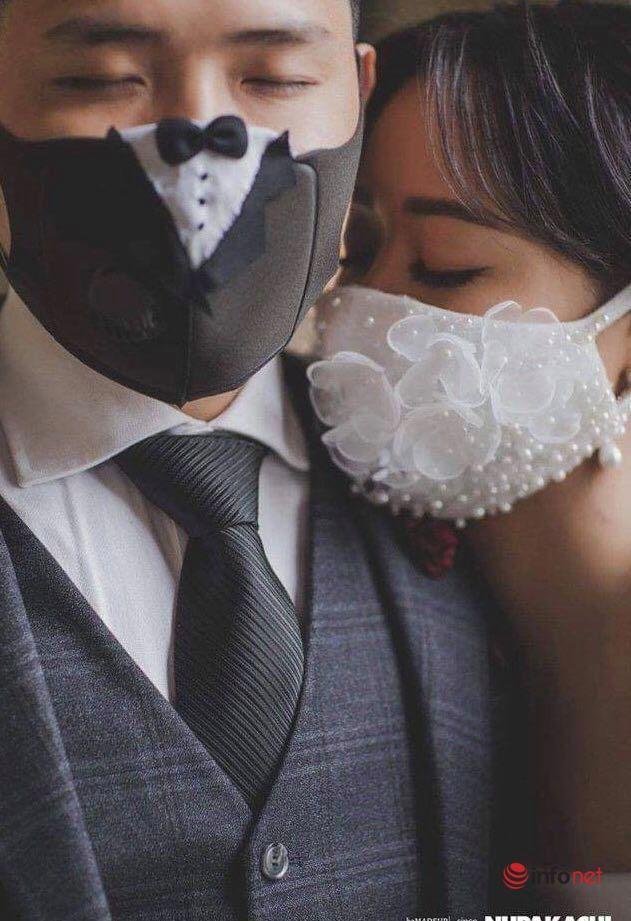 """Giữa dịch Covid-19, bộ ảnh cưới cô dâu chú rể đeo khẩu trang gây """"sốt"""" mạng xã hội"""