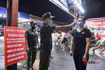 Hà Nội: Phun khử khuẩn, đo thân nhiệt tất cả những người vào chợ đầu mối Long Biên