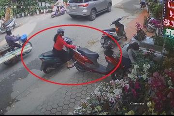 """""""Nữ quái"""" diện đẹp bật cốp xe trộm ví chỉ 10 giây, nạn nhân vẫn mải miết chọn hoa"""