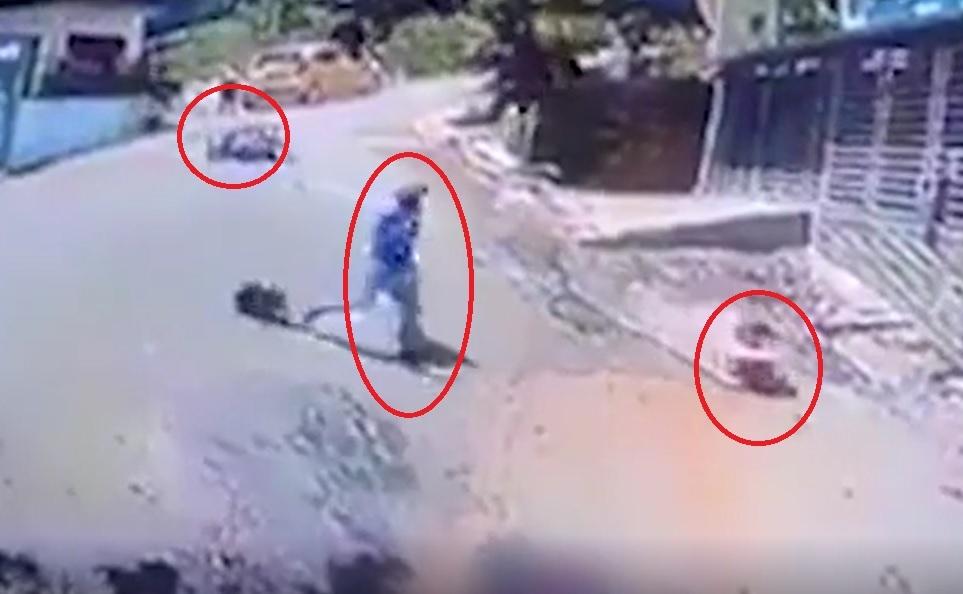 Thanh niên vứt xe máy lao ra cứu em bé bị trôi xe tập đi giữa đường