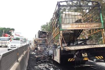 Xe tải chở đồ mỹ nghệ cháy trơ khung sau cú tông trực diện container trên QL1A