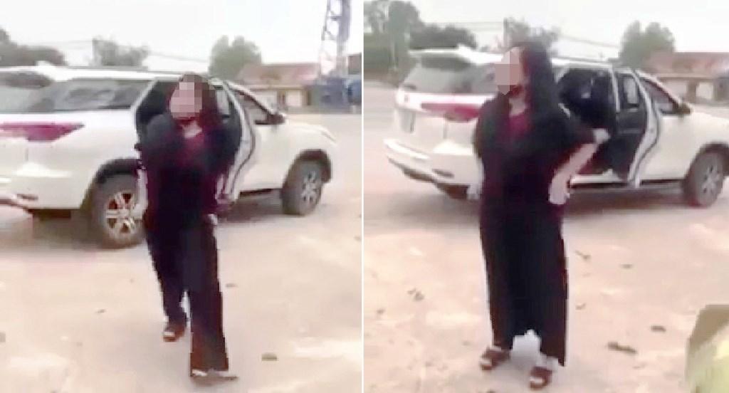 Người phụ nữ xuống xe chửi bới, làm hành động phản cảm ở cổng đền Cuông