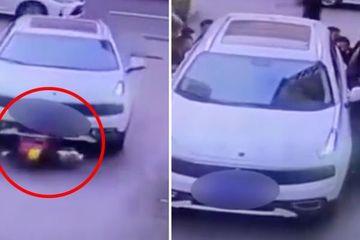 Người đi bộ hợp sức nâng ô tô, giải cứu cậu bé bị cuốn dưới gầm xe