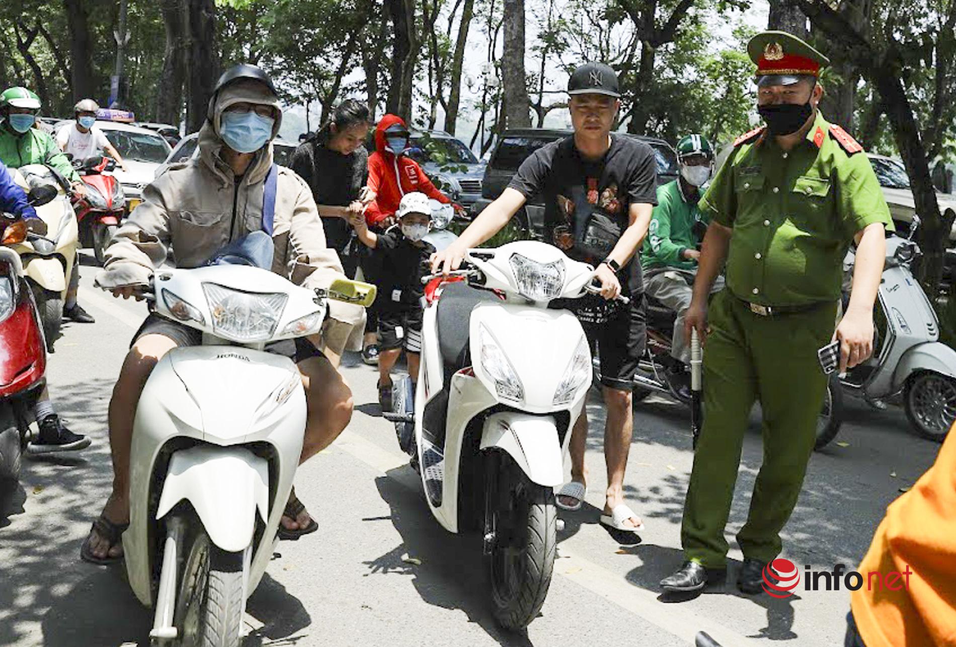 Hà Nội: Ra đường không đeo khẩu trang, nhiều người bị phạt