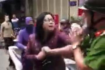 Hà Nội: Công an lập hồ sơ xử lý người phụ nữ náo loạn trên phố, mạo danh là công an