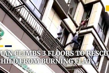 'Người nhện' tay không trèo 3 tầng cứu bé trai trong ngôi nhà cháy