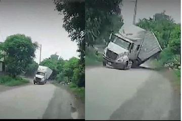 Tài xế ô tô con nhanh trí đánh lái thoát vụ xe container lật nghiêng kinh hoàng trước mắt